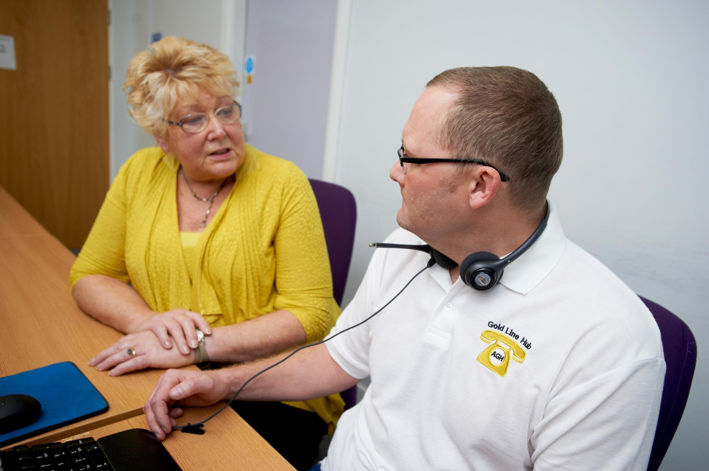 Mrs Jane Walton, a carer on the Gold Line project team, talking to nurse Andrew Farrar in the Gold Line hub