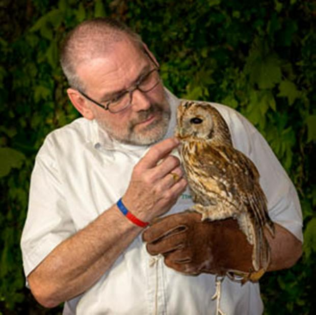 Howard Toll with an owl