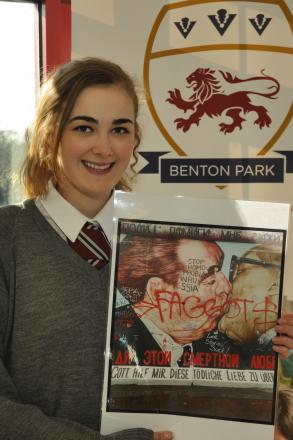 Ella Weeks with a copy of the piece of work which inspired her in the ARTiculation competition