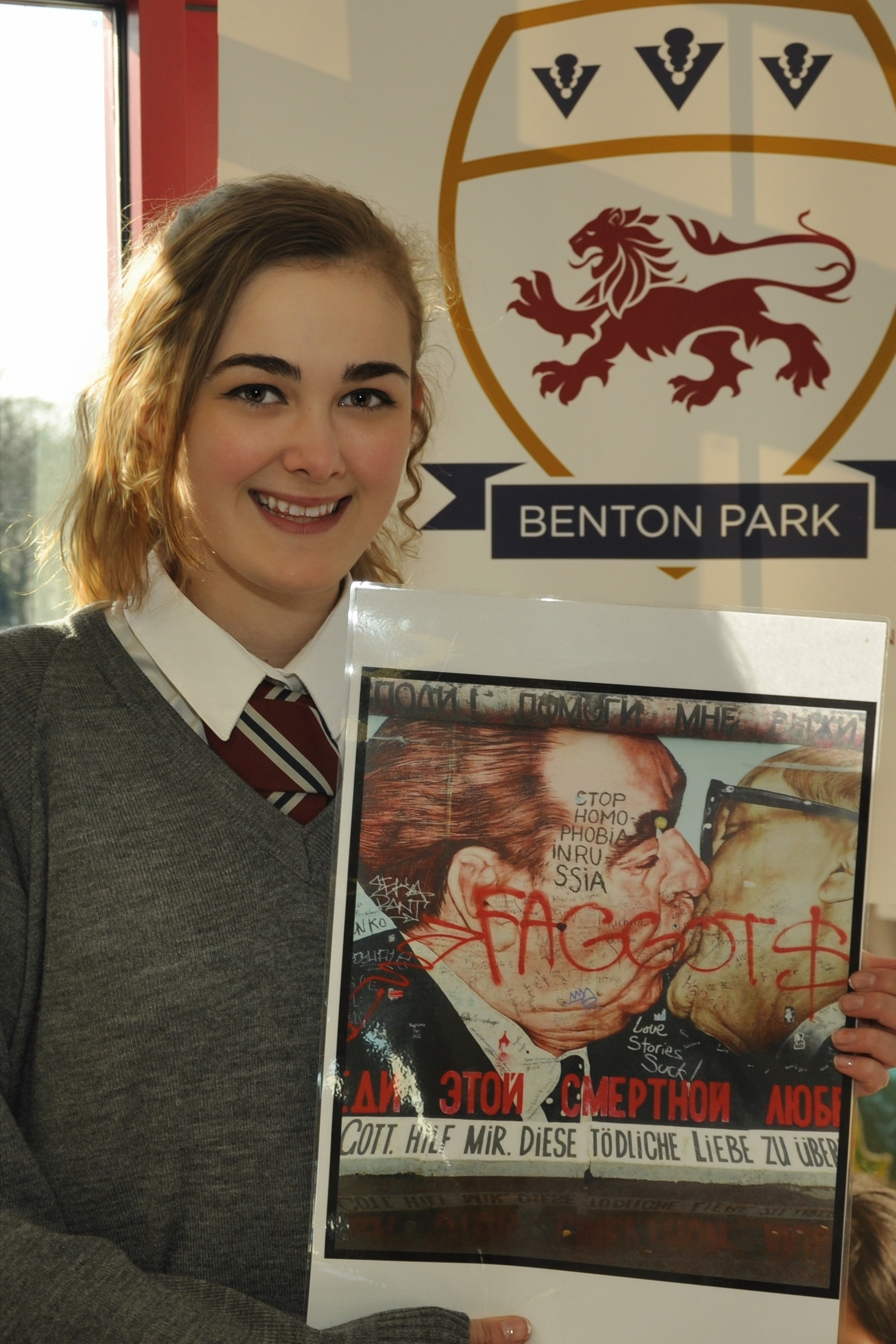 Ella Weeks with a copy of the piece of work which
