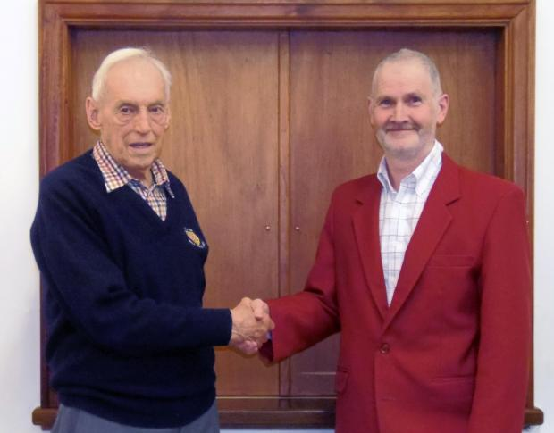 Wharfedale Observer: Paul Duff, right, receives his red choir jacket from Ken Wardell