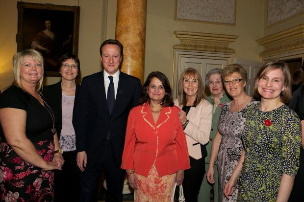Pam Clarke, third from right, with the Prime Minister at the reception at Number 10 Downing Street with fellow winners
