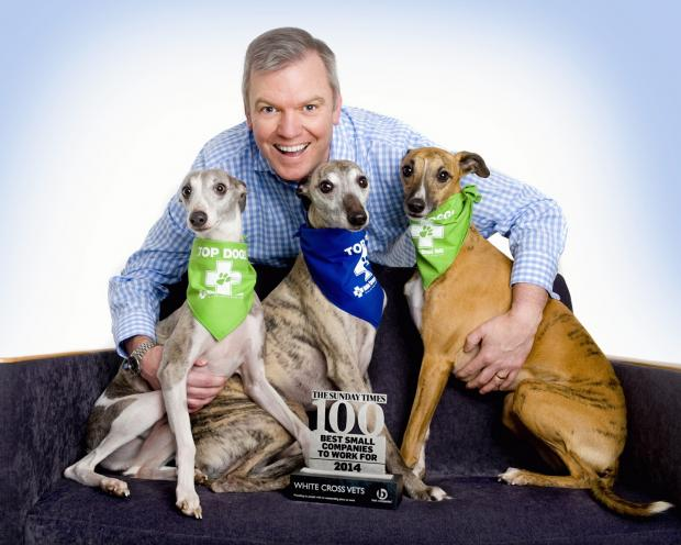 Tim Harrison from White Cross Vets with a trio of whippets celebrating the award