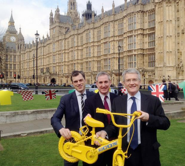 MPs, from left, Julian Smith, Greg Mulholland and Andrew Jones mark 100 days until the Grand Depart in Westminster