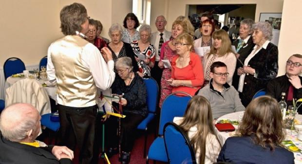 Otley Courthouse Community Choir member Elizabeth Hodgson (front row, third from right) celebrating her 80th birthday. The choir's oldest member, 89-year-old Derek Naylor, is second from left at the back