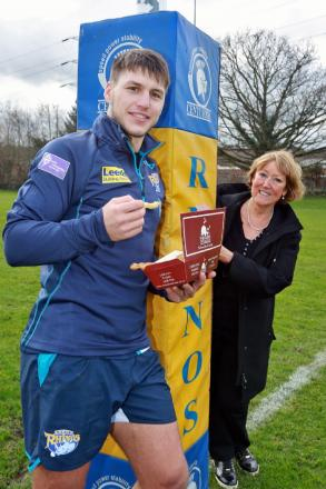 Rhinos'  signing Tom Briscoe with The Wetherby Whaler's Janine Murphy