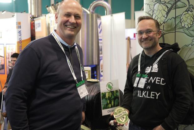 Paul Corbett, of Charles Faram and Co hop merchants, with Chris Ives, managing director of Ilkley Brewery, at SIBA BeerX where the Olicana hop was unveiled