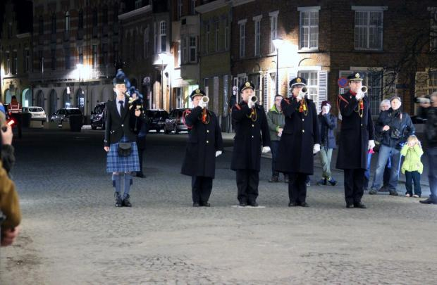 Air Cadet Calum Carslaw, left, of the 1224 (Wharfedale) Squadron playing the pipes at the Menin Gate memorial