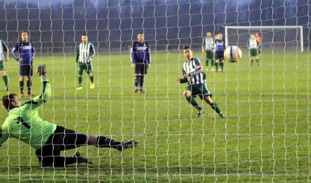 Wharfedale Observer: Michael Rhodes scores from the spot for Steeton to give them a 1-0 victory over Goole United in their West Riding County FA Challenge Cup semi-final at Fleet Lane. Picture: Simon Pickles