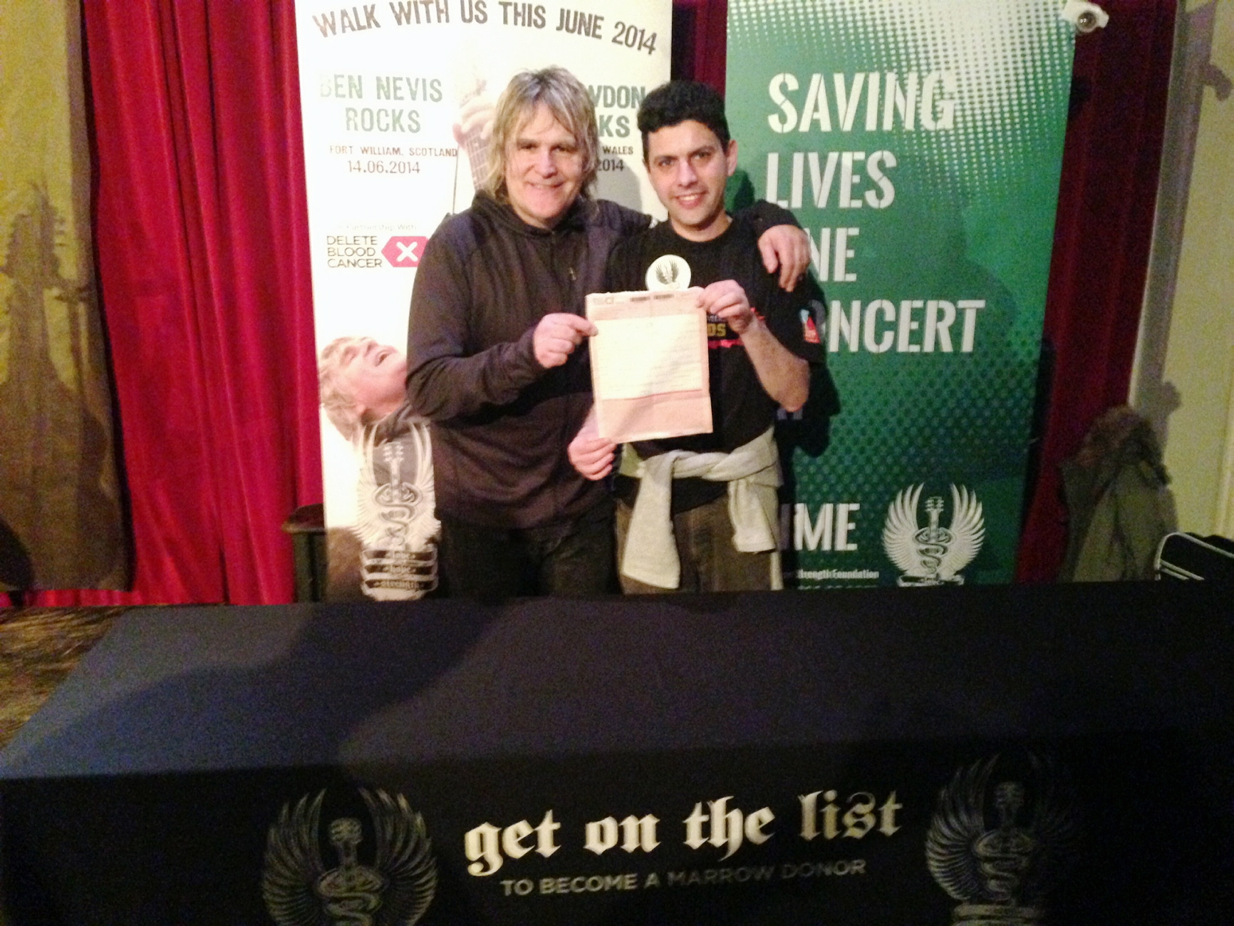 Mike Peters (left), frontman from The Alarm, recruiting bone marrow and organ donors at his sell-out Otley show, with Councillor Alex Sobel