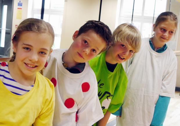 Pupils from Ashlands School in Ilkley wear the yellow, green, white and polka dot jerseys to celebrate the Tour de France coming. From left are Martha Pearson, Kieran Blenkhorn, Nat Howarth and Louise Hale