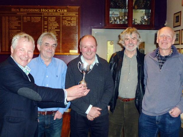Ian Briggs of the Rotary Club of Ilkley (far left) presents the Andrew Hartley Cup to the winners of the business quiz, a team from Allison & MacRae Architects of Burley-in-Wharfedale, from left Steve Nicholson, Michael Allison, Don MacRae and Brian Roger