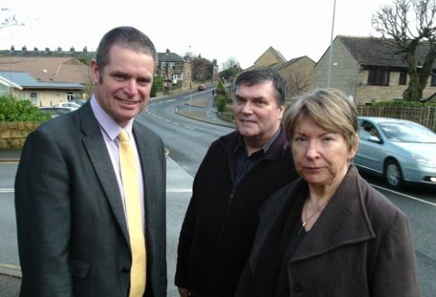 Ward councillor Ryk Downes with local residents – and Town Councillors – Jim and Pauline Spencer beside busy Burras Lane, in Otley