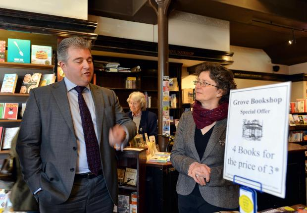Wharfedale Observer: Minister Brandon Lewis, who has responsibility for making the high street prosper, on his tour of some Ilkley shops, pictured with manager of The Grove Bookshop Carol Peel
