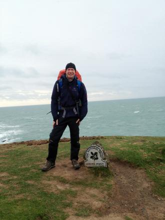 Former Prince Henry's Grammar School pupil Adam Dawson, at the most southernly point on mainland Britain, Lizard Point, in Cornwall, where Adam starts his walk