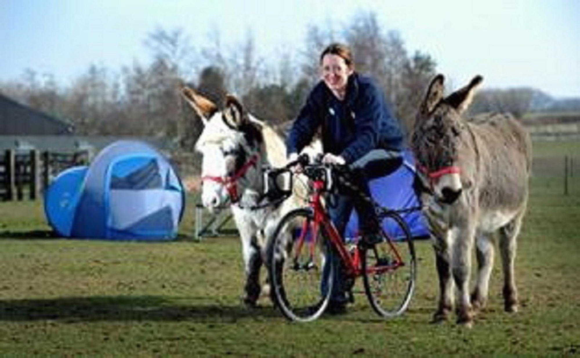 Centre manager at The Donkey Sanctuary Cathryn Williams gets on her bike ready for the Tour de France