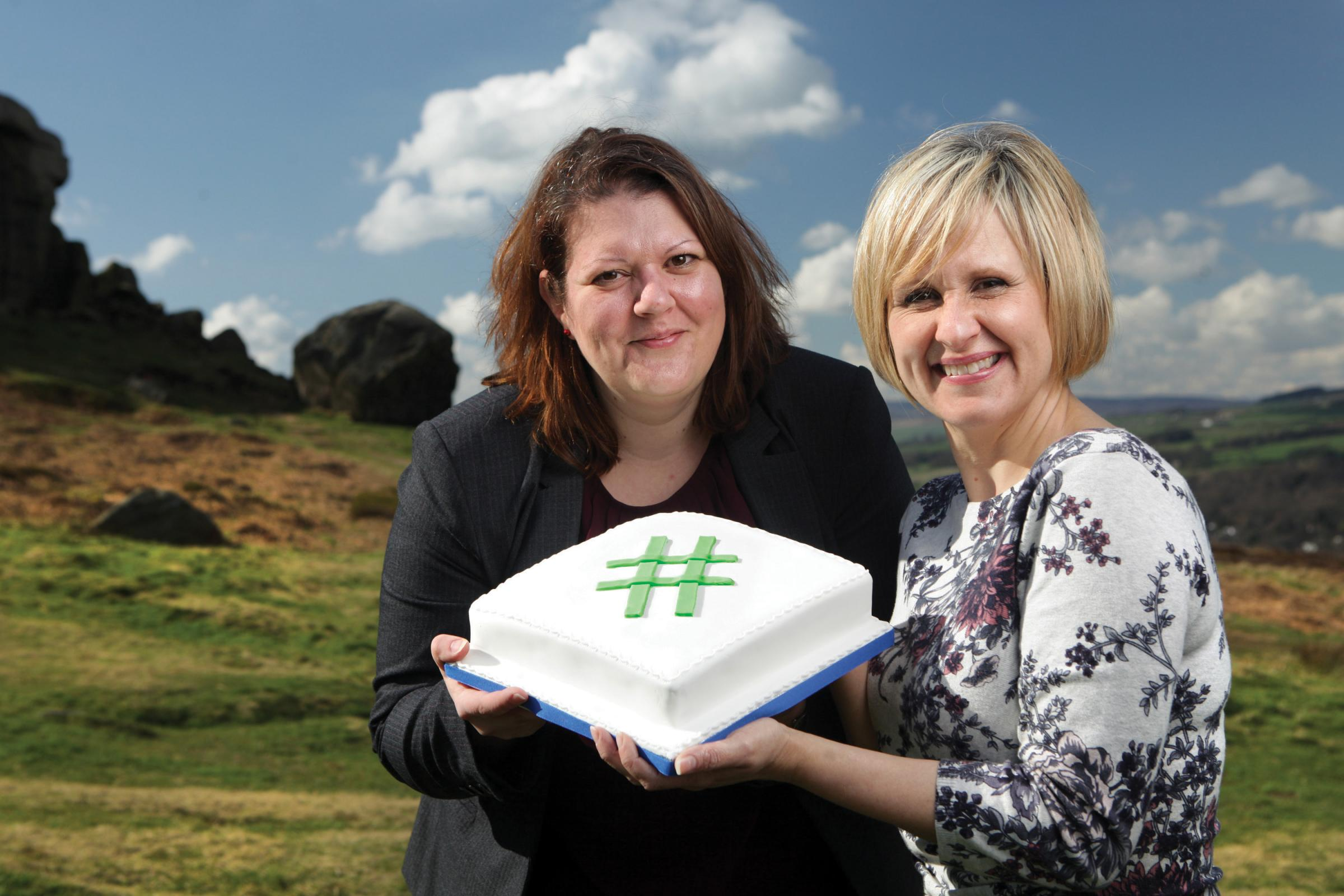 Regular #ilkleyhour tweeter Mary Moore, of Moore Than Cakes, presents Approach PR managing director Suzanne Johns with a celebratory hashtag cake to celebrate #Ilkleyhour's first anniversary