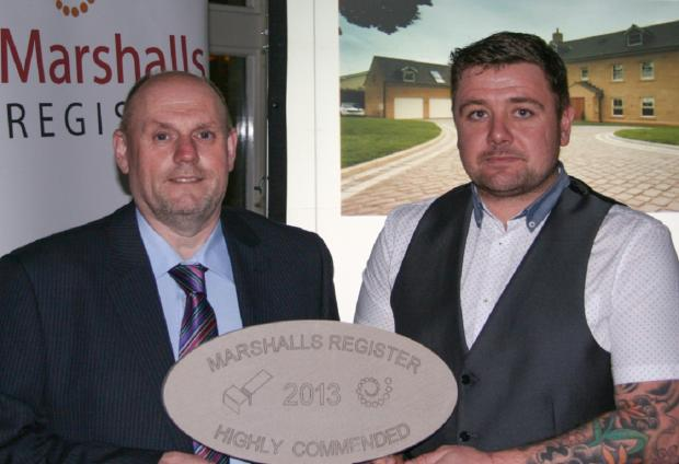 Tom Armitage from Yorkshire Pro Paving (right) being presented with his award by Peter Montgomery of Marshalls