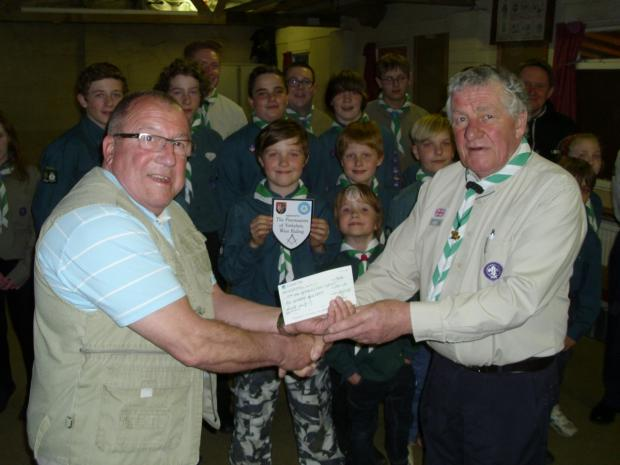 David LeGrove (left) of Olicana Lodge presents the cheque to Scout group leader Dougie Lawson
