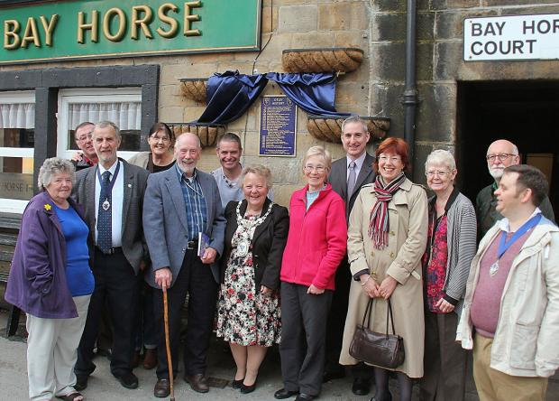 John Morgan (front row, third from left) with Otley Town Mayor Councillor Pam Gill, guests and others who contributed to the new history plaque and book. Picture by John Chippendale