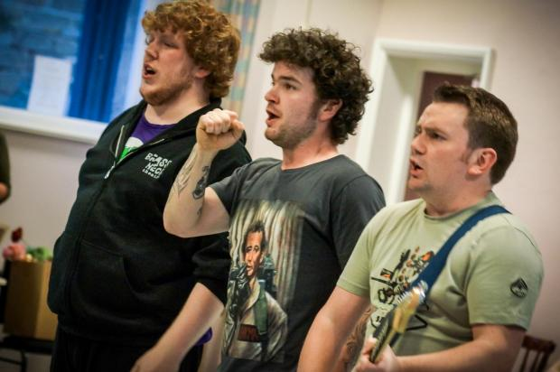 From left are Adam Folkard, Ben Tomlinson (who plays the lead   role of Robbie Hart) and Tom Kyle during rehearsals for The Wedding Singer