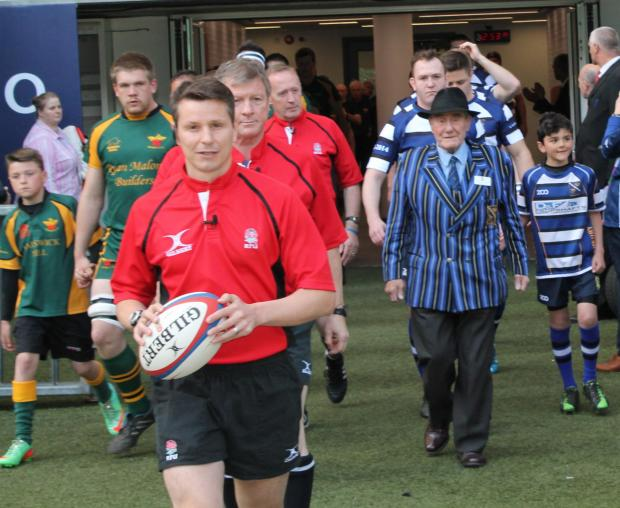 Raymond Johnson (with hat) leads out the side at Twickenham on his special day