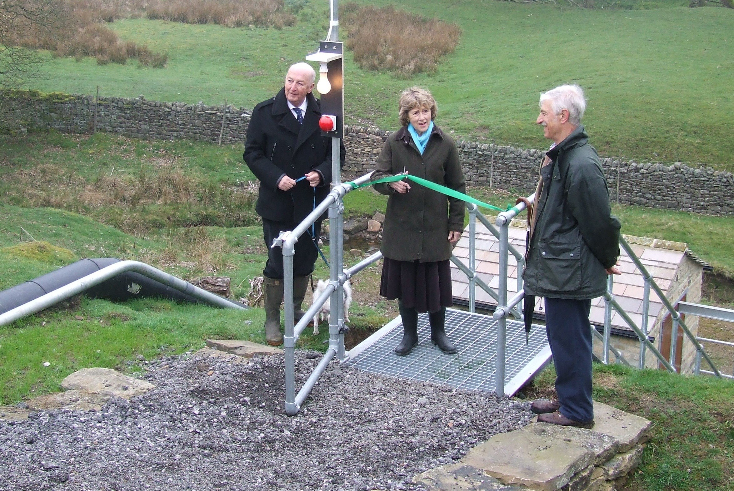 The Duke and Duchess of Devonshire, Peregrine and Amanda Cavendish, with engineer Norman Wheat at the new hydro-electric system