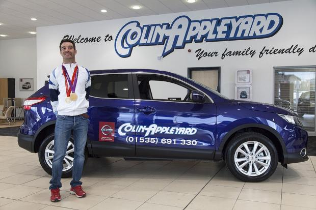 Paralympic cyclist David Stone with his car sponsored by Colin Appleyard