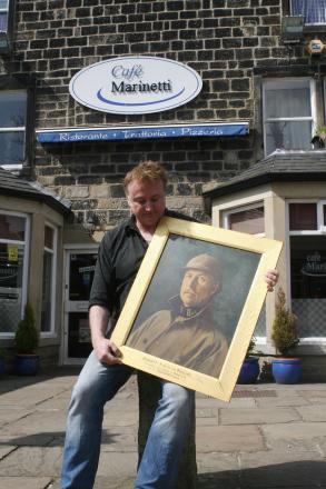 Mark Saville, project manager of Horsforth's WWI 100 Years Project, holding a portrait of the Belgian King Albert,  presented to the town by Belgian refugees
