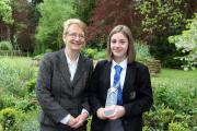 Head teacher Gillian James with Emma Powell and her Local Hero award