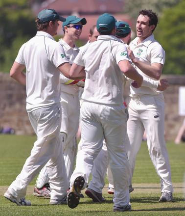 Otley celebrate last weekend after James Davies takes a wicket against Ilkley