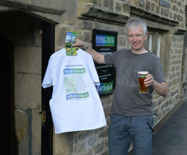 Endurance runner Mark Selby with the souvenir Ales Trail T-shirt and a pint of his favourite ale