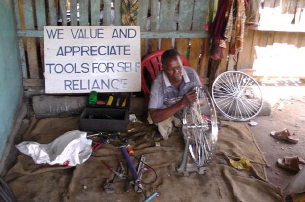 A workman at Yusufu Mchanjama Bicycle Repair, in Lindi, Tanzania, making use of tools sent by Tools for Self Reliance