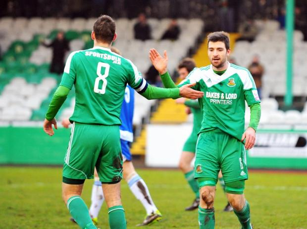 Nicky Boshell, right, being congratulated on a goal for Avenue by skipper Nathan Hotte, seems set to stay at Horsfall Stadium