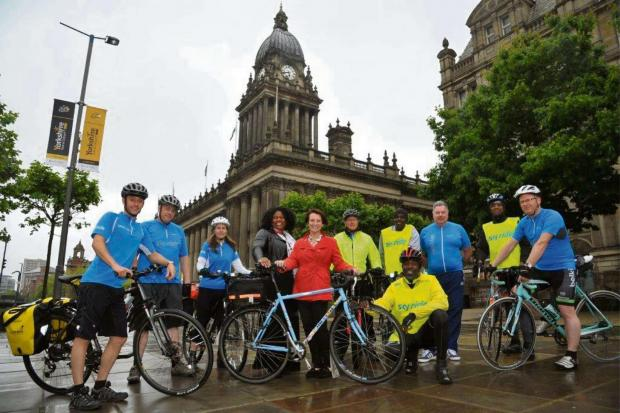 Wharfedale Observer: (6777202) Leeds City Council executive member for leisure and skills Cllr Lucinda Yeadon (centre) with centre left Heather Nelson chief executive of Black Health Initiative together with British Cycling ride leaders and members of City Riderz