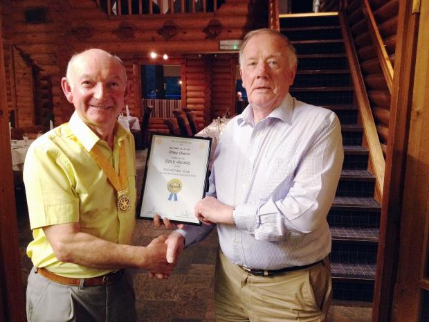 Bryan Kitching (right) receiving an Eco Gold Award on behalf of the Rotary Club of Otley Chevin from the Rotary Club of Otley Chevin's president elect, John Kitchen