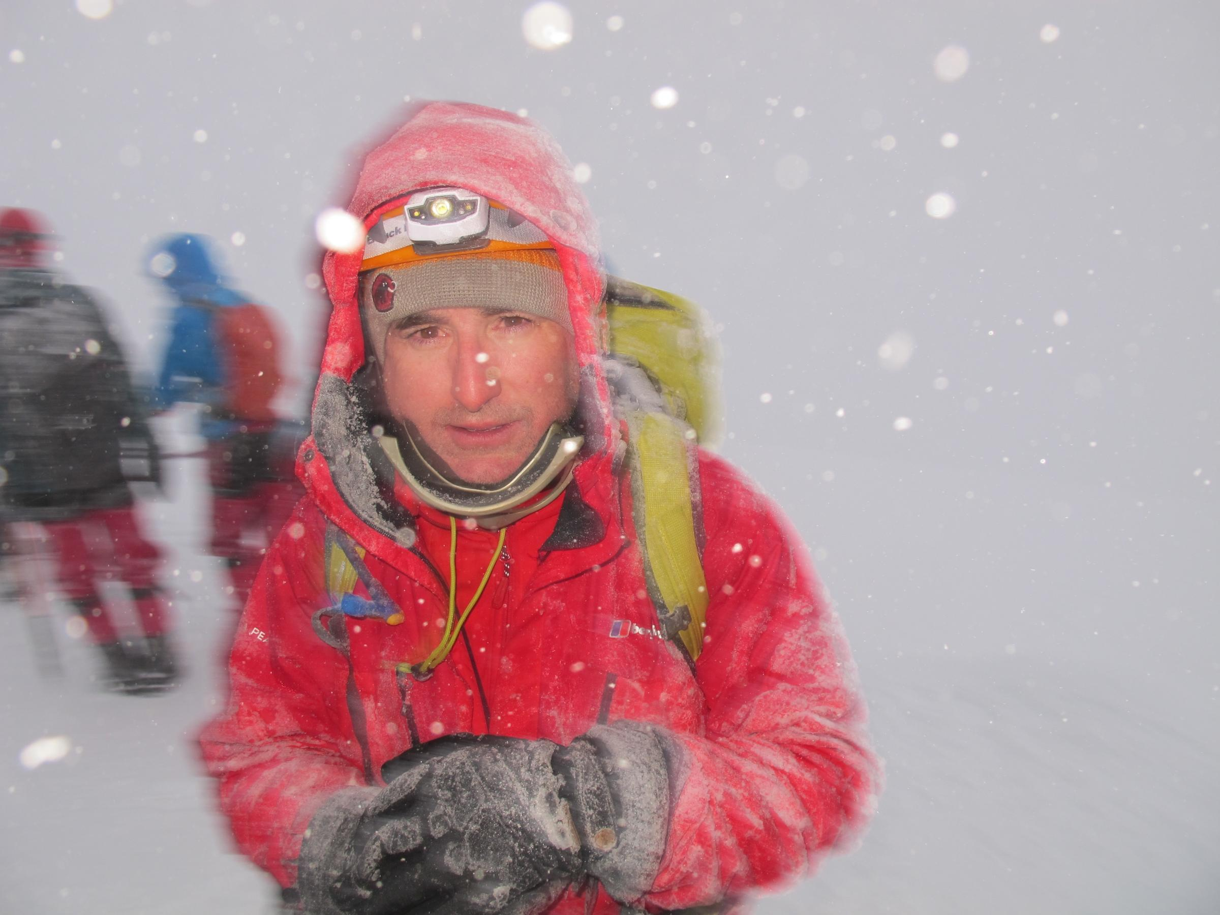 MP battles snow to conquer volcano summit