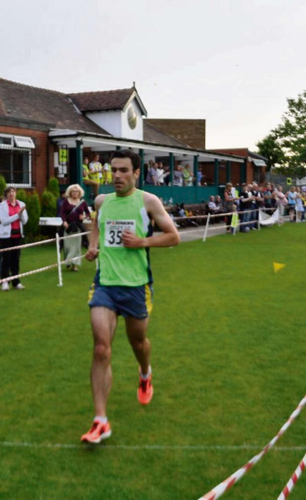 Wharfedale Observer: Race winner Nathaniel Williams crosses the line at Otley Cricket Club