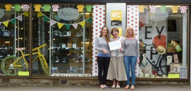 The winning display at Artamis Gifts / Jamers Barber Tobacconists, on Westgate, Left to right:  Alicia Barber, Otley Carnival Committee chairman Wendy Corden, and Angela Barber.