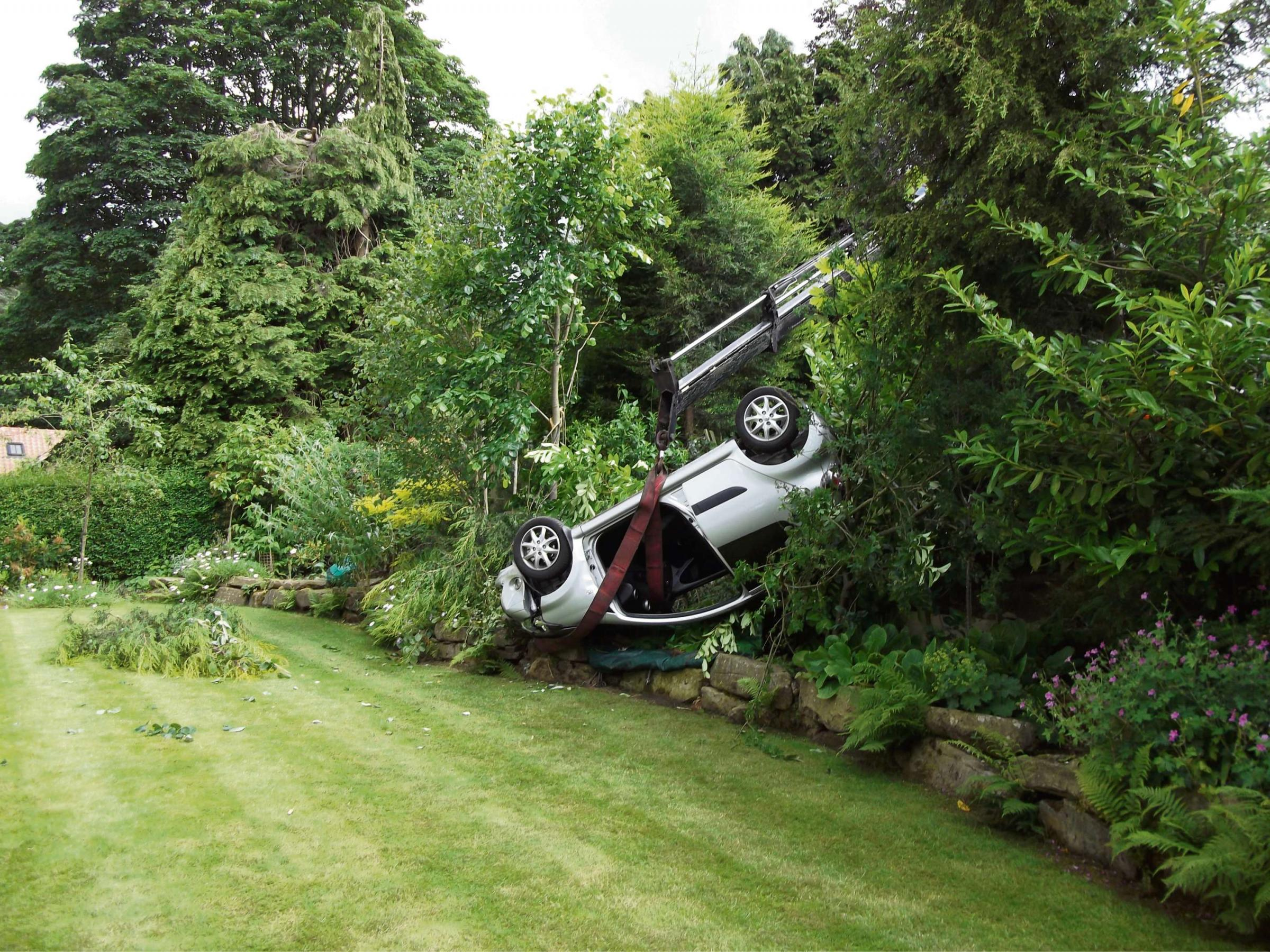 Two lucky to alive after car ploughs into garden