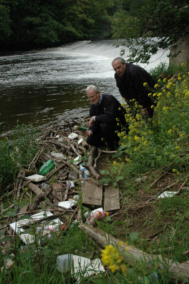 Wharfedale Observer: (7253380)Coun Townsley (right) and Coun Hughes looking at the rubbish