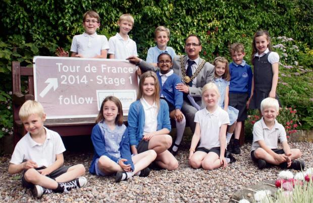 Please find attached some pictures of the TdF signs in Addinghampicture of kids with hi-vis jackets: L-R -  Kian, Annie, Alex, Freya, Nishita, James, Thomas, Prada, Arianwen, William, Fiona and Findlay.  (7218507)