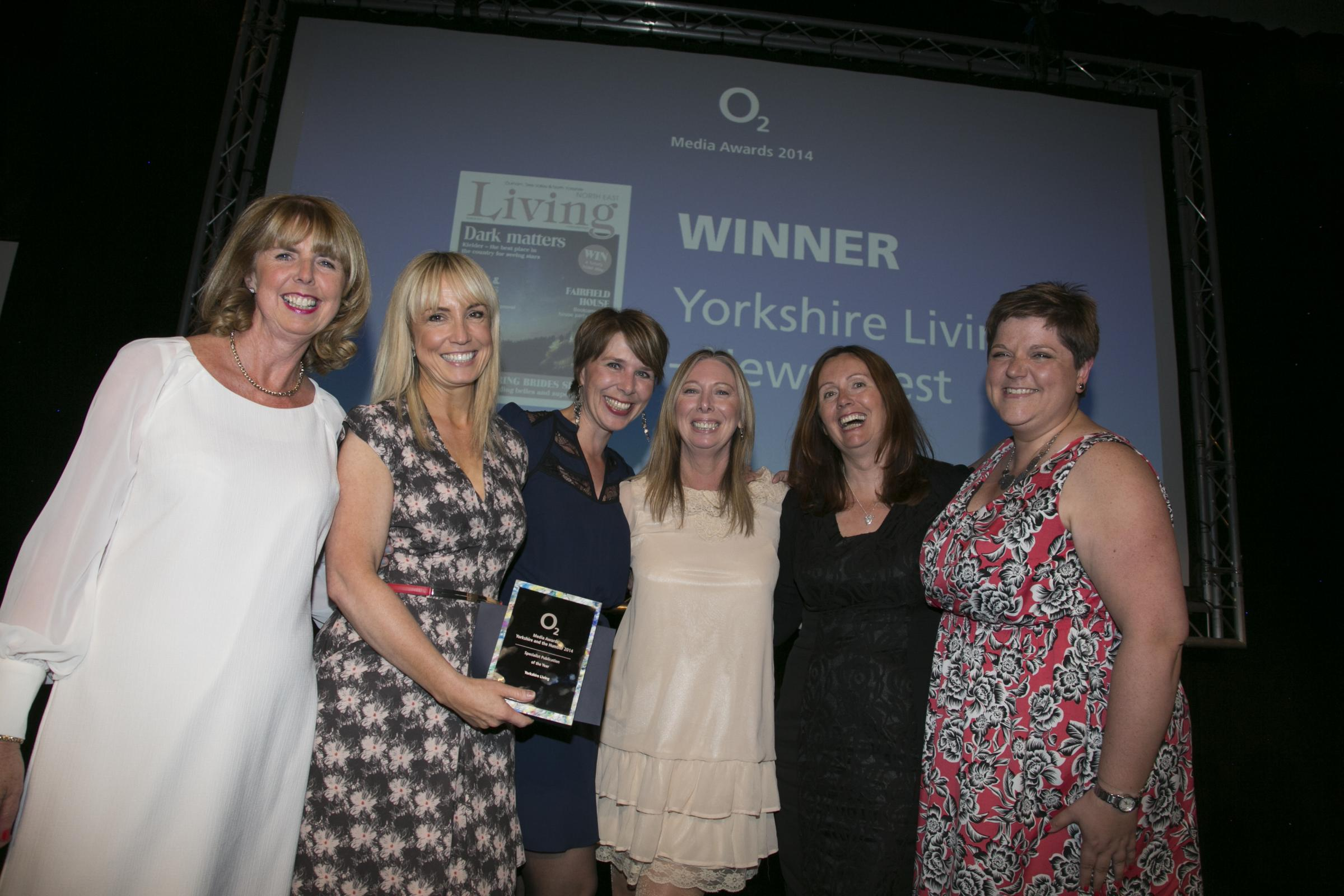 Receiving Yorkshire Living's award from Ann McCracken, O2 Communications North, are: Jenny Thompson, Publisher; Maxine Gordon, Feature Writer; Sue Mayman, Advertising Executive; Francine Clee, Editor, and Becky Cheeseman, Designer