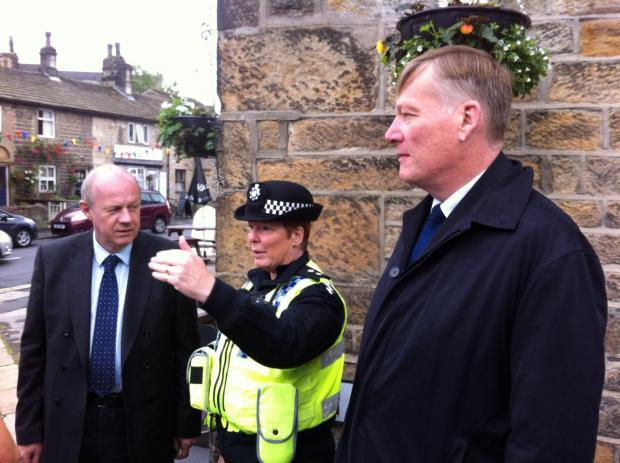 (7718639)(From left) Policing Minister Damian Green, Inspector Sue Sanderson and Keighley and Ilkley MP Kris Hopkins discussing Addingham's Tour de France preparations.