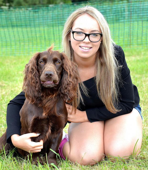 Wharfedale Observer: Abbie Nutchey 16 from Pool with her 2 year old cocker spaniel Hugo, in the working dogs section.