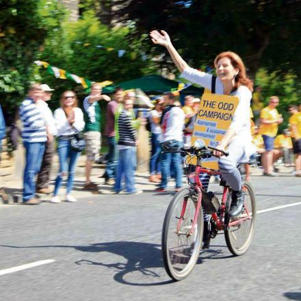 Otley campaigner Cathy Theaker getting her point across while riding in the Tour de France caravan
