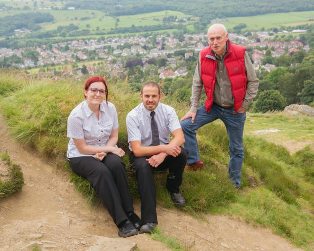 Wharfedale Observer: Pictured: Staff from Ilkley Booths walk up Cow and Calf Rocks in Ilkley with Chairman of Booths, Edwin Booth. Andrea Hartas, Customer Service Manager, and Sam Overend, Fresh Cabinets Manager, from Ilkley Booths with Edwin Booth, Chairma