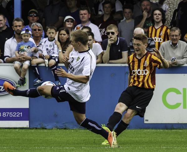 Triallists Grant Roberts, left, of Guiseley, and Sam Wright of Bradford City in action during their pre-season clash at Nethermoor on Saturday. Picture: www.caughtinactioncollection.co.uk