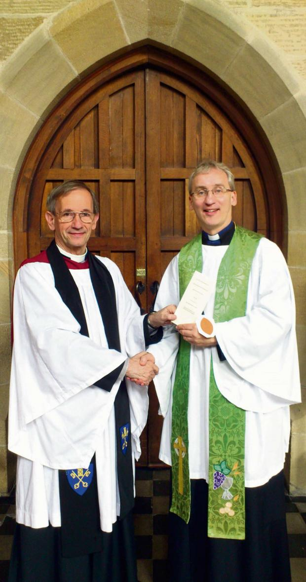 Wharfedale Observer: The Archdeacon of Bradford, the Venerable David Lee (left), formally inducted the Rev Peter Willox (right) as vicar of St Johns Ben Rhydding on Sunday (September 16).