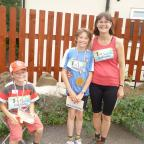 Wharfedale Observer: Pictured after finishing the Tour de  Riddlesden fun run are, from left, Joshua, Zac and Elspeth Cansdale.